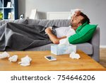 sick man with fever lying on... | Shutterstock . vector #754646206