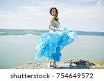 brunette girl  wear on blue...   Shutterstock . vector #754649572