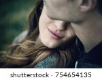 young loving couple relaxing on ... | Shutterstock . vector #754654135