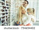 happy family choosing glasses... | Shutterstock . vector #754654402