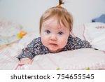 little white baby girl  lying... | Shutterstock . vector #754655545