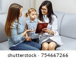 the doctor and a young mother... | Shutterstock . vector #754667266