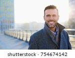 portrait of happy businessman... | Shutterstock . vector #754674142