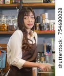 girl barista bartender waiter... | Shutterstock . vector #754680028