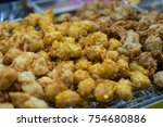 Small photo of corn fritter in tray ,street food