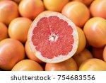 pile of fresh grapefruits on... | Shutterstock . vector #754683556