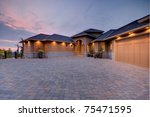 luxury home exterior at sunset | Shutterstock . vector #75471595