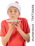 Teenage boy with a mince pie - stock photo