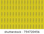 rows of paper clips on a yellow ... | Shutterstock . vector #754720456