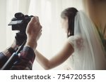 the cameraman takes off the... | Shutterstock . vector #754720555