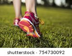 runner feet running on road... | Shutterstock . vector #754730092
