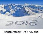 2018 written in the snow ... | Shutterstock . vector #754737505