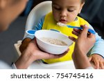 african american mother feeding ... | Shutterstock . vector #754745416