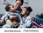 african american mother in... | Shutterstock . vector #754745452