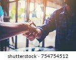 businessman handshaking process ... | Shutterstock . vector #754754512