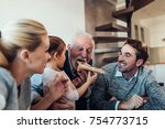 three generation family eating... | Shutterstock . vector #754773715
