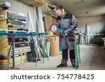 worker cutting metal with...   Shutterstock . vector #754778425