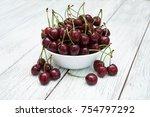 ripe juicy cherries on a wooden ... | Shutterstock . vector #754797292