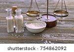 Small photo of Glass bottle with drag pills , mortal, scale in homeopahty on wooden table