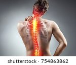young man holding his neck in... | Shutterstock . vector #754863862