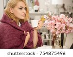attractive blonde young woman... | Shutterstock . vector #754875496