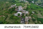 drone view of green fields  and ... | Shutterstock . vector #754913602