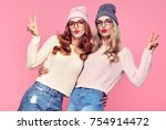 two young woman blowing lips... | Shutterstock . vector #754914472