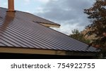 textured metal roof. | Shutterstock . vector #754922755