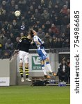 Small photo of SOLNA SWEDEN - OCT 30, 2017: Soccer player in the game AIK and IFK Gothenburg jump and nick the ball. October 30 2017,Solna,Sweden