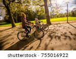 happy young coupe riding... | Shutterstock . vector #755016922
