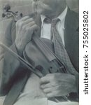 Small photo of James Duff, Appalachian fiddler in Hazard, Kentucky, ca. 1934. By Doris Ulmann who made seven trips to the rural South between 1928-1934, photographing tradition bound people with a modern sensibility