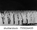Nocturnal gathering of robed and hooded Ku Klux Klan men in 1921-1922. Photo by National Photo Company and was likely taken within 100 miles of Washington, D.C.