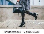 stylish woman walking in city...   Shutterstock . vector #755039638