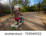 young woman riding a bike at... | Shutterstock . vector #755040532