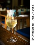 glass with cold white wine on... | Shutterstock . vector #755071456