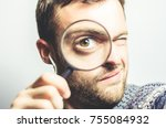 bearded man with a magnifying... | Shutterstock . vector #755084932