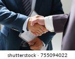 man in suit shake hand as hello ...   Shutterstock . vector #755094022