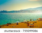 Small photo of View of the beach of Palma de Mallorca with people lying on sand, aea and palm trees. Palma-de-Mallorca, Balearic islands, Spain.