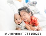 little sister hugging her baby... | Shutterstock . vector #755108296