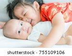 little sister hugging her baby... | Shutterstock . vector #755109106