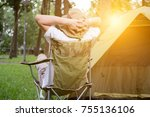 young man tourist sitting on... | Shutterstock . vector #755136106