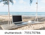 laptop and a cup of coffee sea... | Shutterstock . vector #755170786
