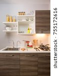 Small photo of Modern kitchen with sample of home projects. The proportion is perfect for convenient use.