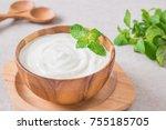 yogurt in wooden bowl | Shutterstock . vector #755185705
