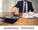 businessman pressing calculator ... | Shutterstock . vector #755264365