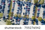 Overhead aerial view of crowded public parking. Business and shopping concept. - stock photo