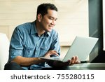 casual young man using laptop... | Shutterstock . vector #755280115