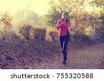 beautiful young woman running...   Shutterstock . vector #755320588
