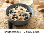 tasty oatmeal with berries in... | Shutterstock . vector #755321206