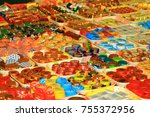 Small photo of Moscow, Russia - September 14, 2016. a wide variety of chocolates of different shapes and in different shiny wrappers lying on the counter alluring buyers